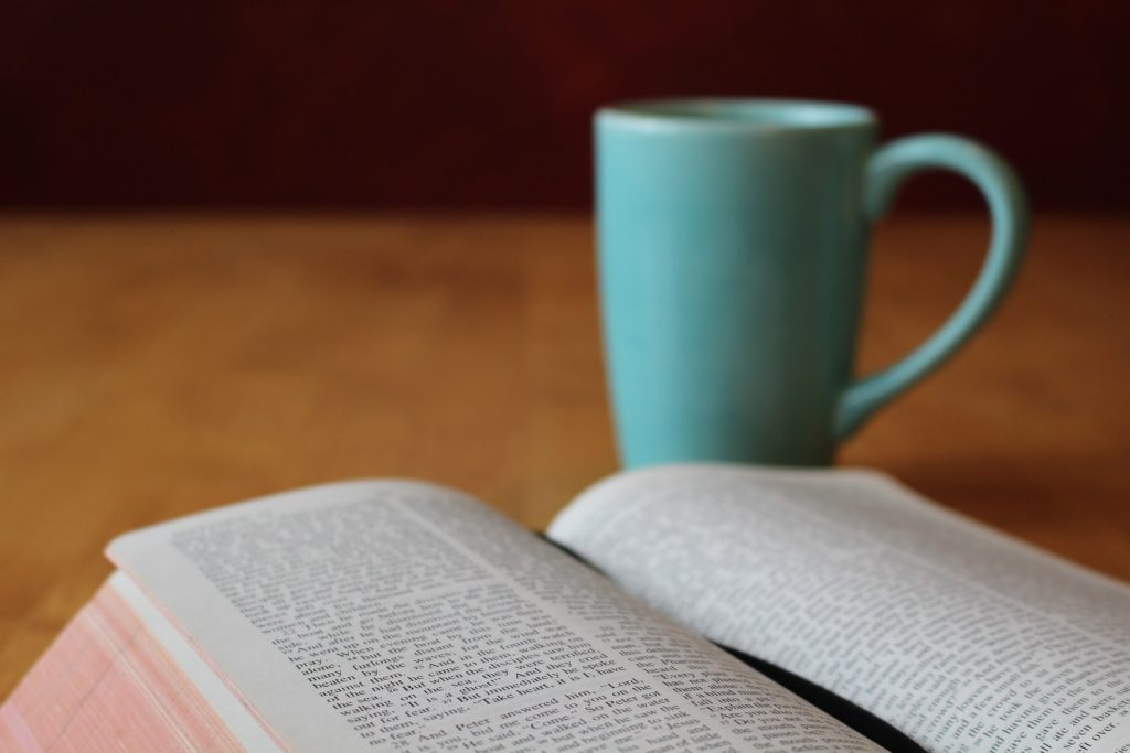 Bible with cup of coffee.