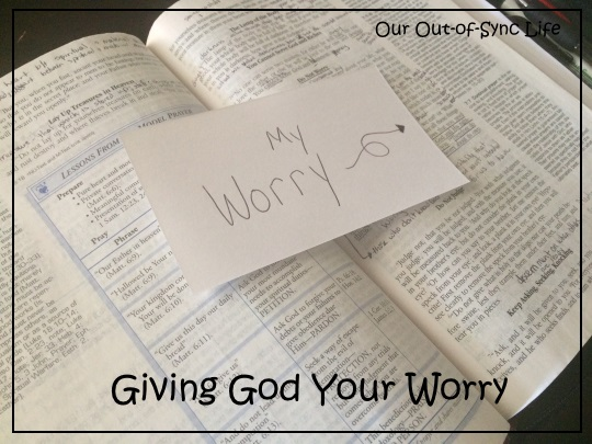 """Bible open with note card saying """"My Worry."""""""