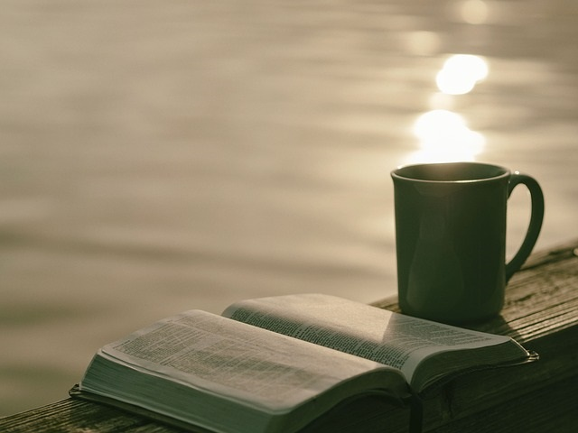 bible and coffee with water background
