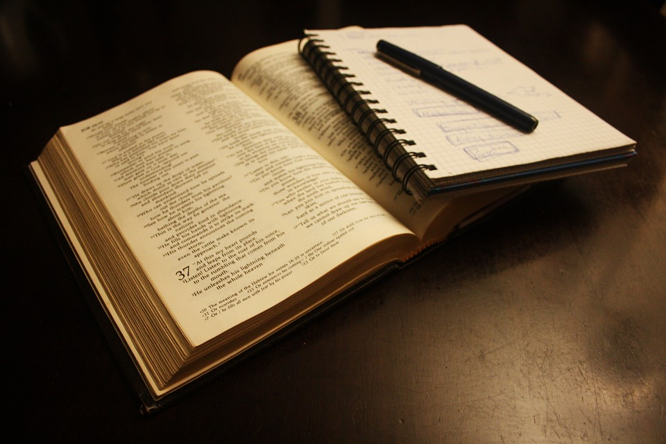 A Bible, notebook, and pen ready for a Quiet Time.