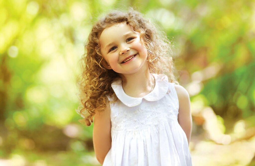Little girl standing in the sun.