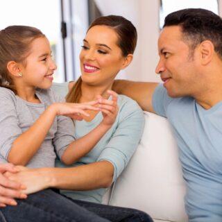 mom, dad, daughter talking