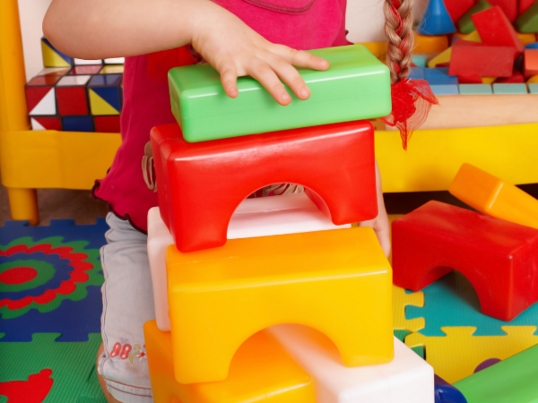 Child playing with blocks to increase Visual Perception skills.