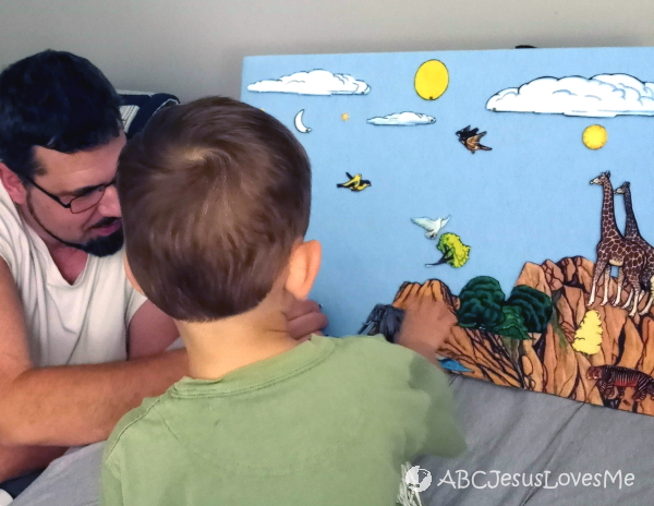 Daddy and son using flannelgraph for intentional Bible learning.