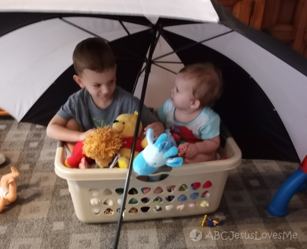 Siblings have play-based learning with Noah's Ark.