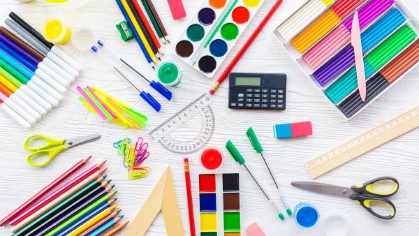 A desk full of school supplies.