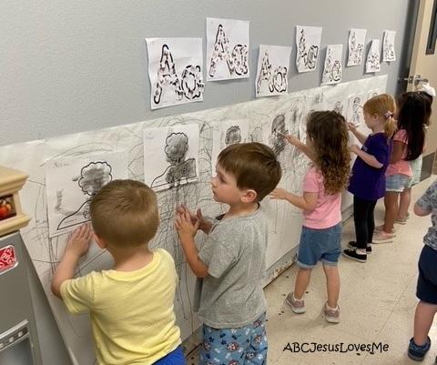 Preschool children painting